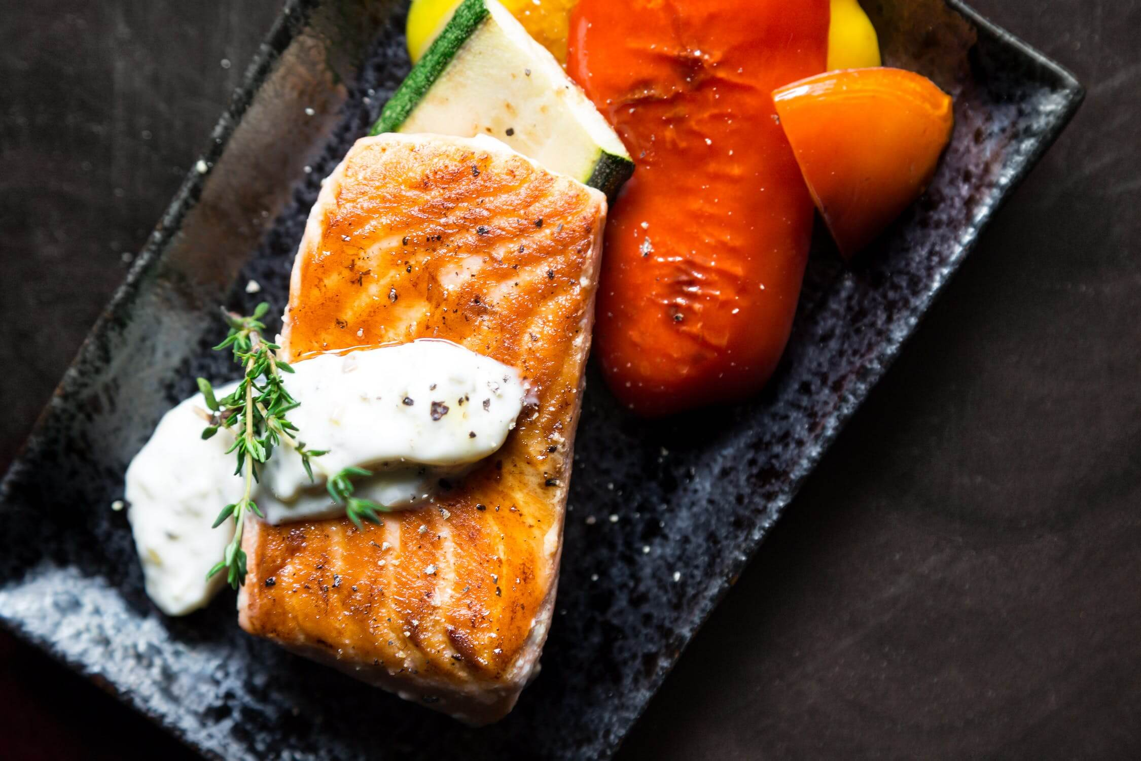 A dinner plate with fresh salmon on it. Oily fish is a great option for seniors with diabetes