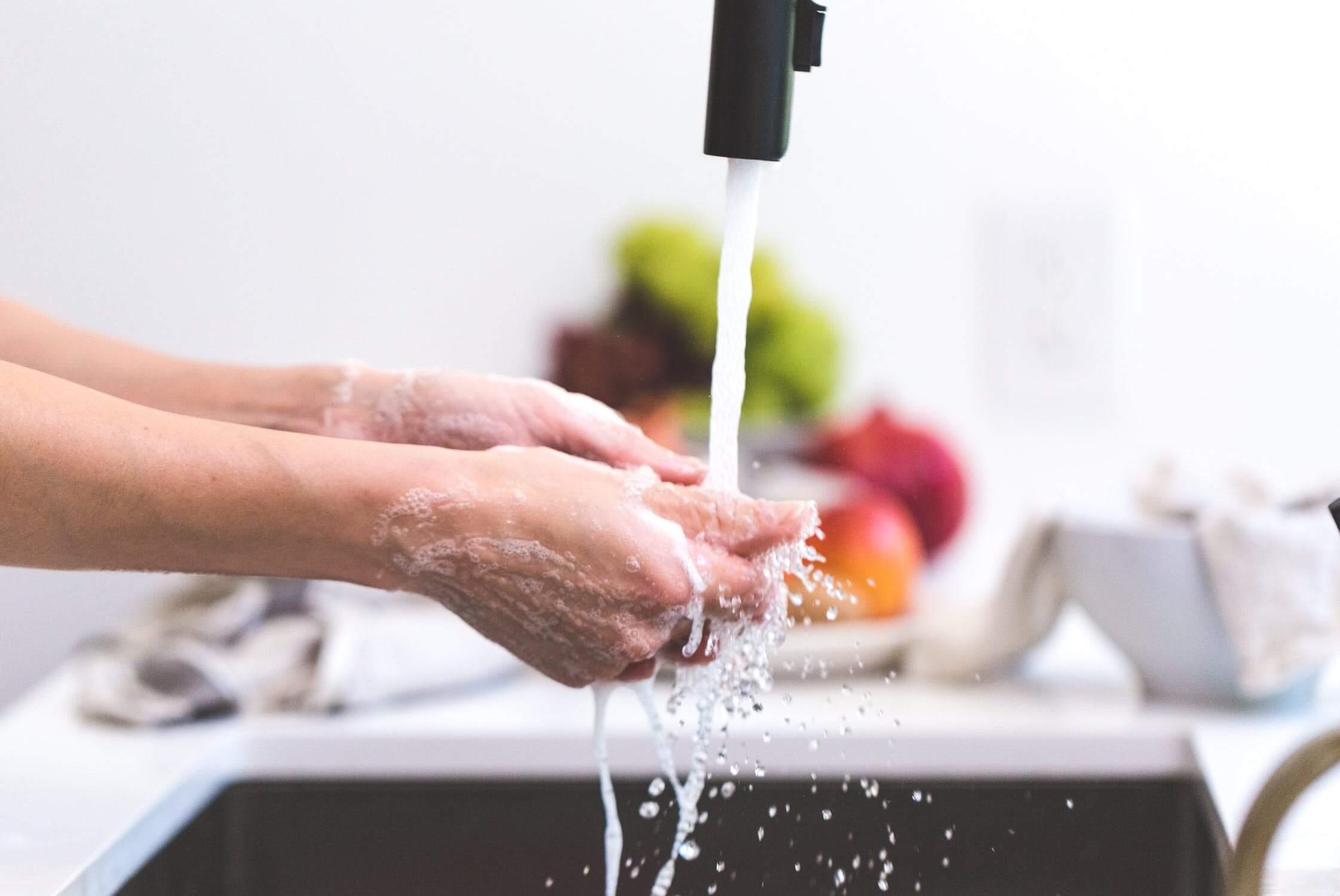 An individual washing their hands.