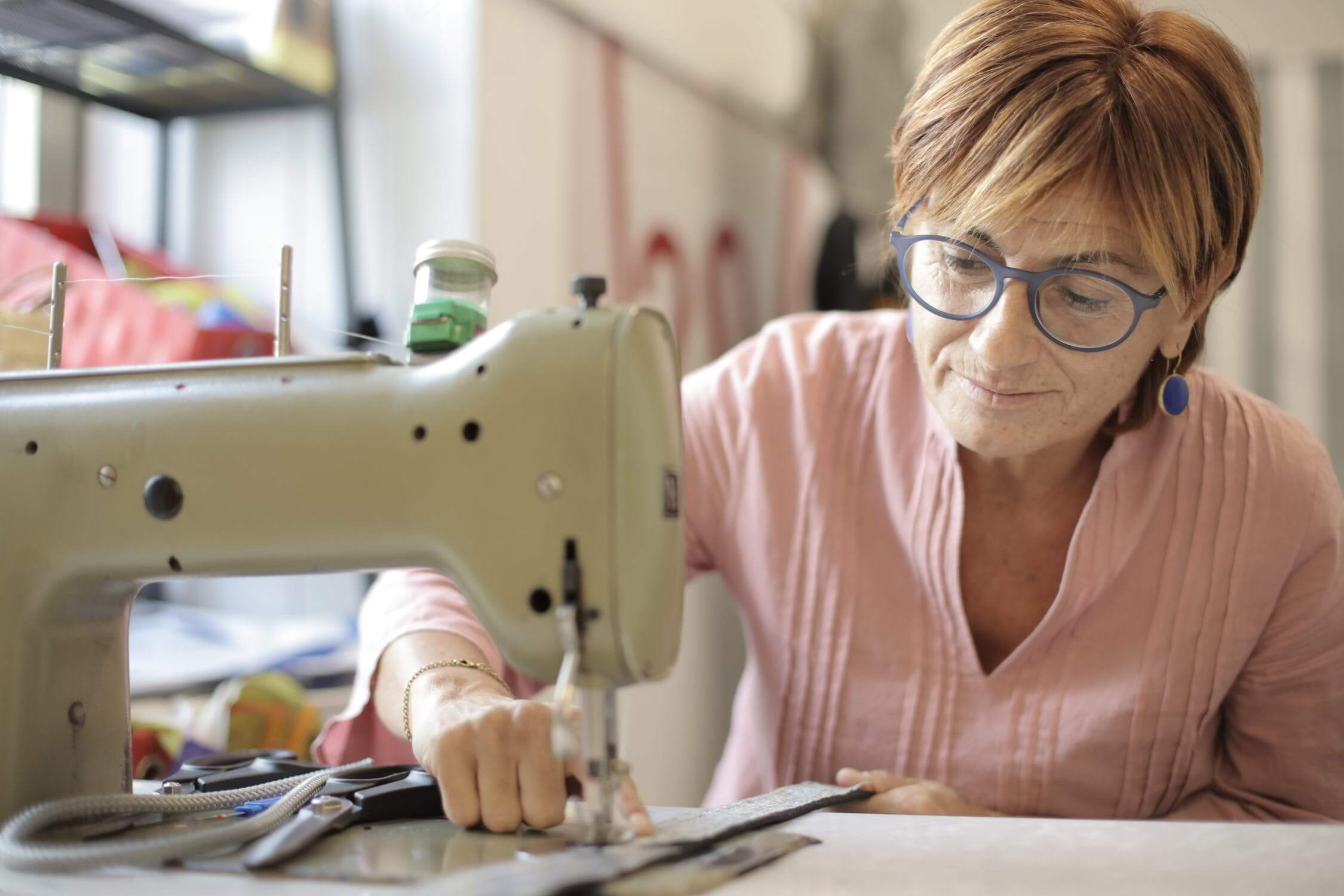 An older woman sewing