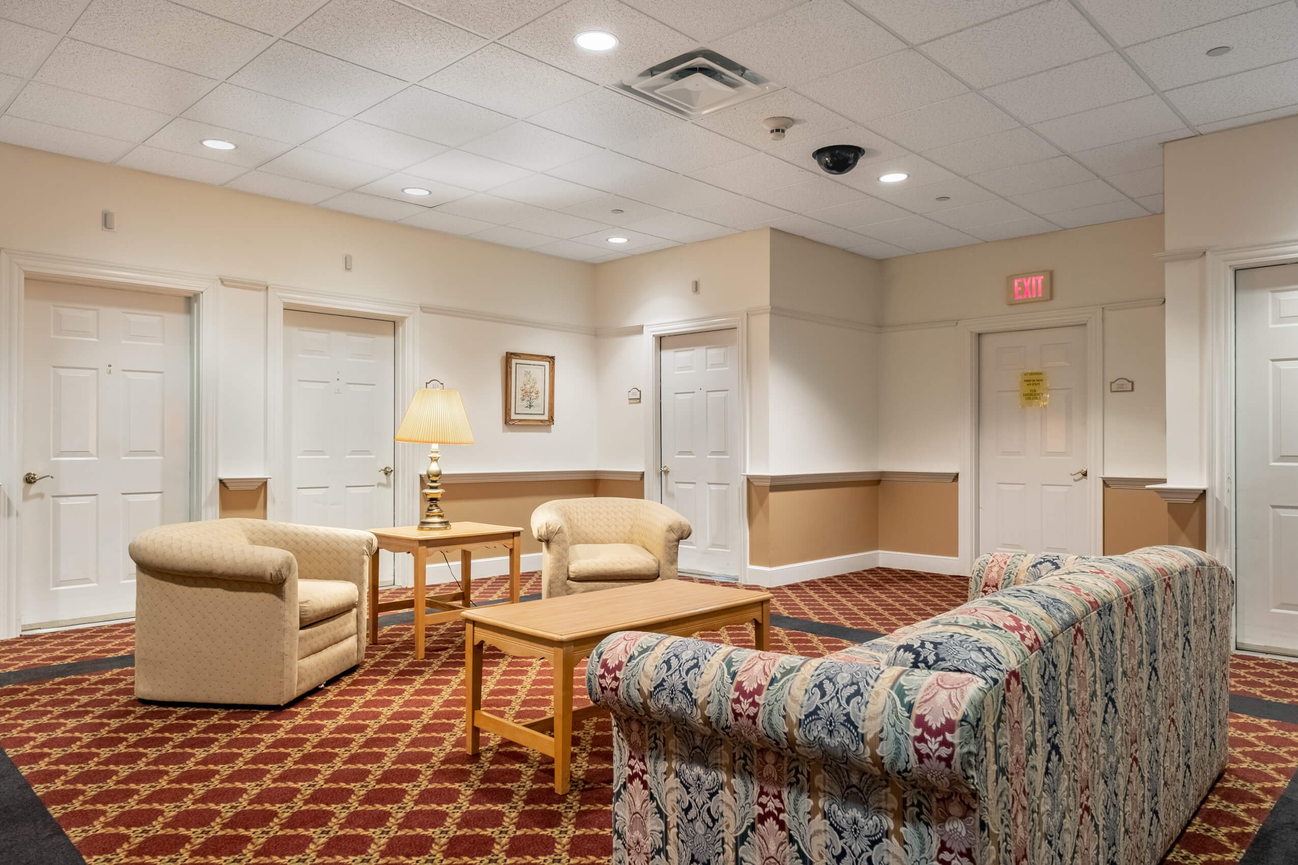 A sitting area outside resident rooms at Landmark at Ocean View, an assisted living facility in Massachusetts