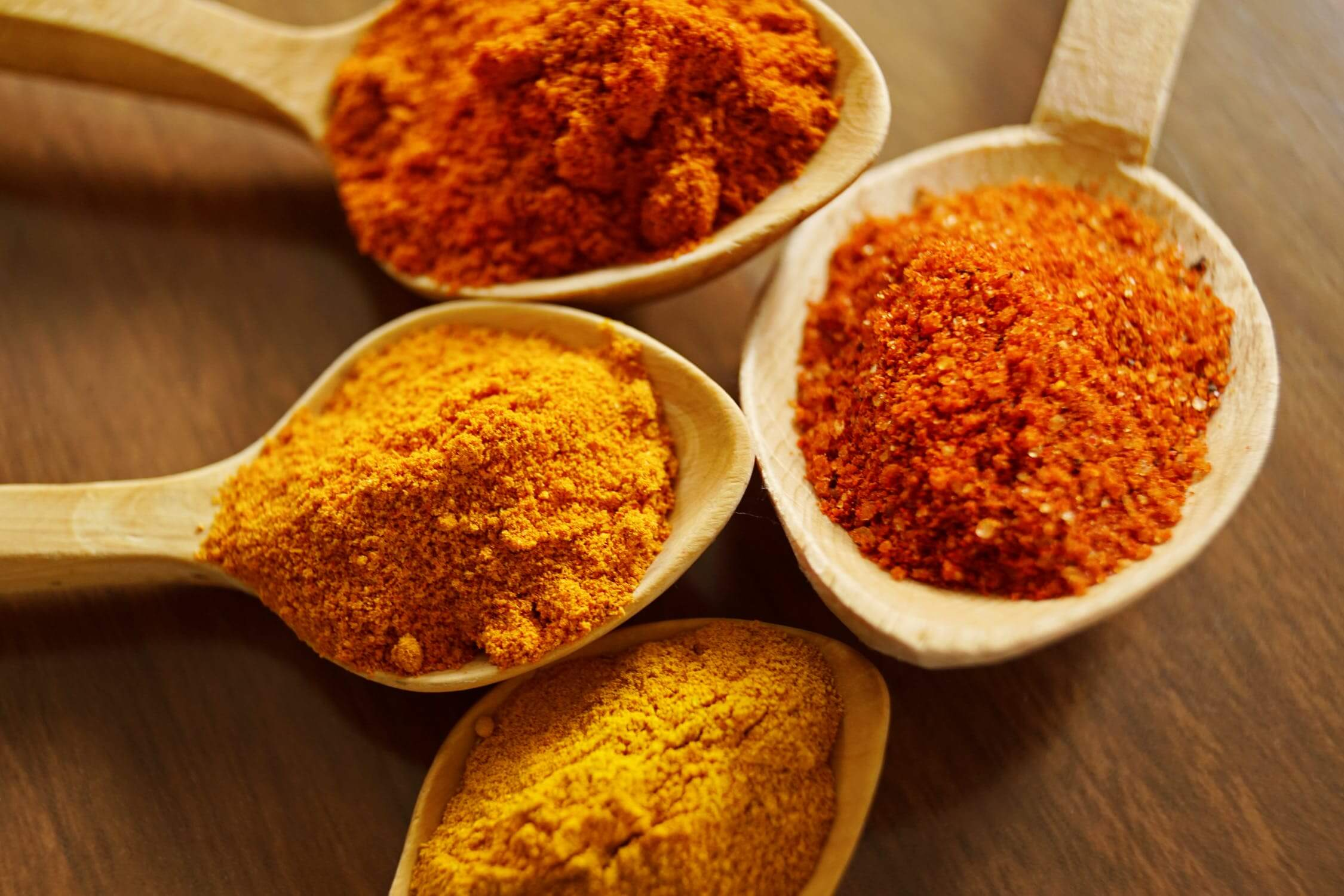 Tumeric in measuring spoons. Tumeric is a healthy option for seniors with diabetes