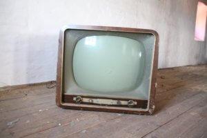 A vintage TV. A fun activity is looking over old home movies.
