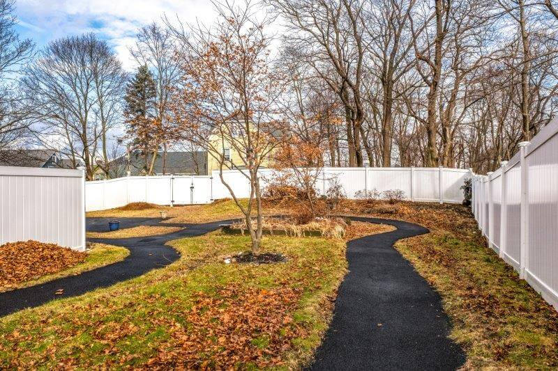The outdoor walking path at Landmark at Ocean View, an assisted living facility in Beverly, MA