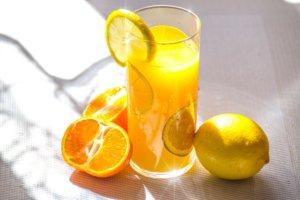 A glass of orange juice with lemons. Increasing vitamin C intake can help individuals avoid allergies