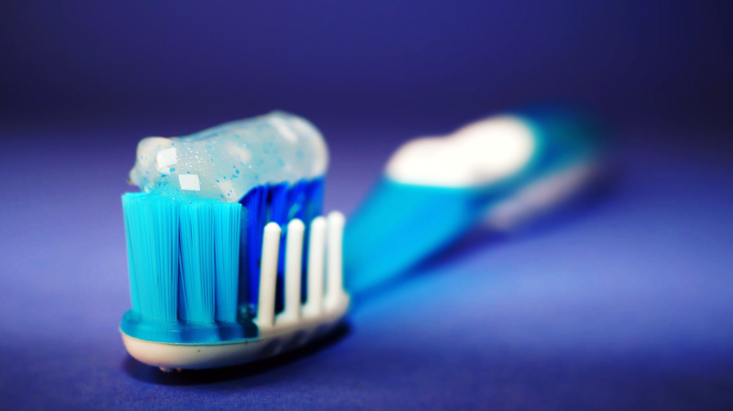 A toothbrush with toothpaste. A toothbrush is a great first step for oral health