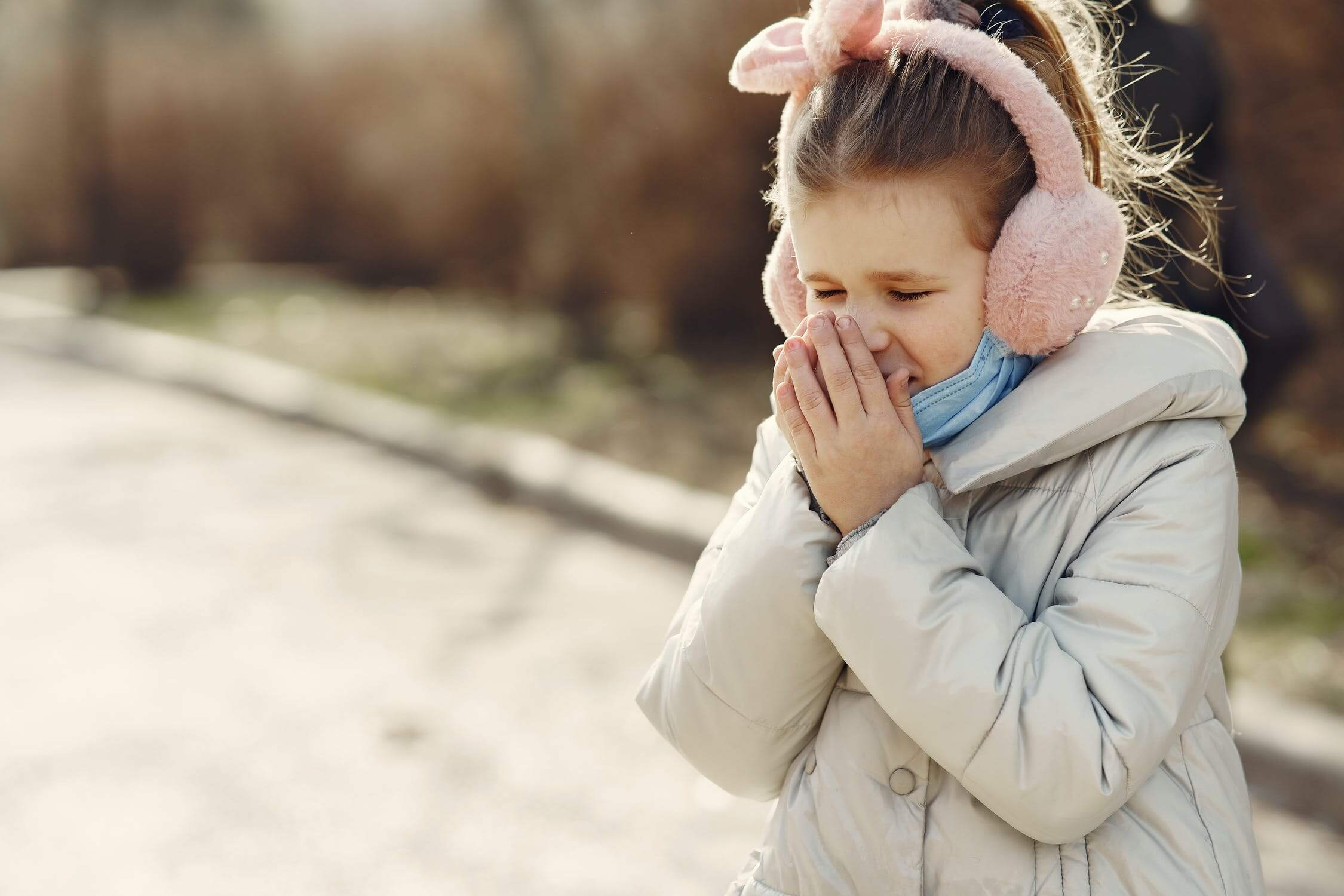 A young girl sneezing. One way to avoid allergies is to take anti allergy medication
