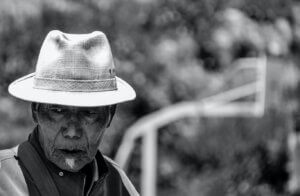 An older man outside and thinking about dementia