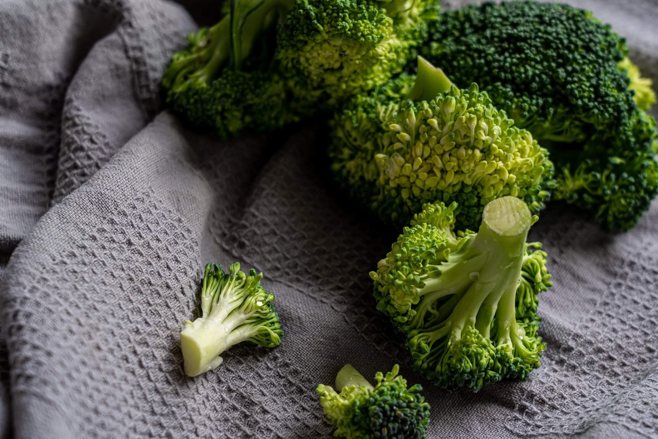 Fresh broccoli florets on a towel. Broccoli is a great brain health food