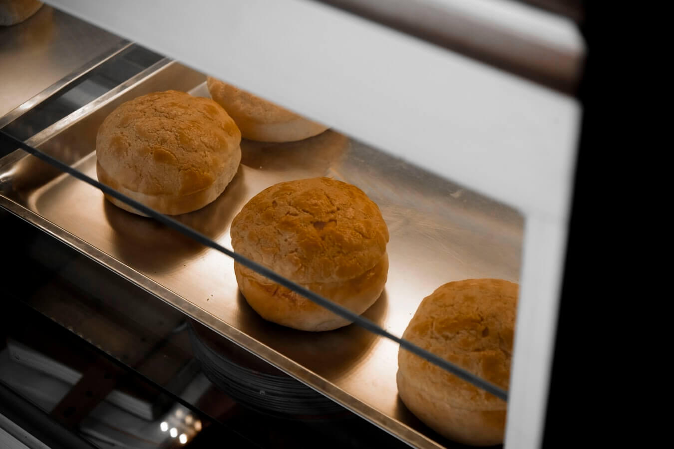 biscuits baking in the oven. Baking is a great fall activitiy for seniors to engage in